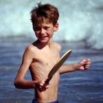 Shirtless Slight Boy At Beach Playing Paddle Ball
