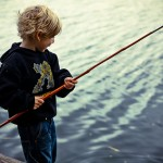 Boy Fishes with cane pole