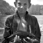 Boy Holding Fish