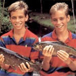 Twin boys with fish