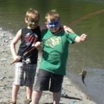 Two Boys Show Off Their Catch