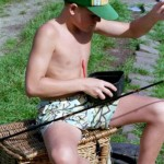 Kid baiting hook to fish