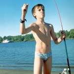 Boy wearing speedos fishing