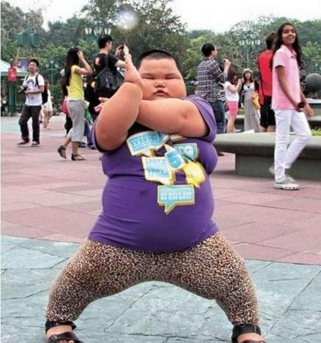Boy does karate wearing leopard skin tights