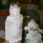Kids wrapped in toilet paper