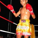 Shirtless Thai Boy Boxing Gloves
