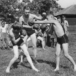 Boxing boys fight in swimsuits
