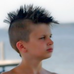 kid with black mohawk
