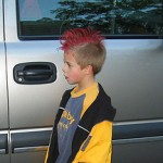 boy poses with red fauxhawk