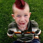Boy has red mohawk