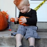 Halloween boy with orange mohawk