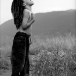 young black kid with dreadlocks shirtless