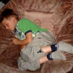 boy sleeping in chair