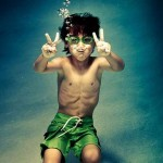 Boy Flashes Underwater Peace Sign