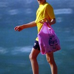 boy with plastic bag at beach