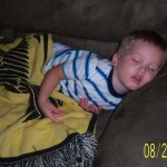 Boy Sleeping On Couch