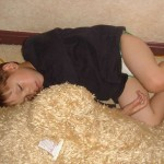 boy sleeping on rug