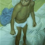boy sleeping in white brief underwear