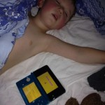 Boy Sleeping with Gameboy