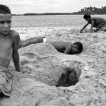 boys dig cave at beach