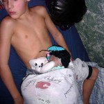 Boy sleeps with stuffed animals in underwear