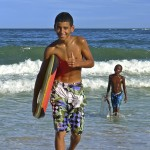 kid with body board at beach
