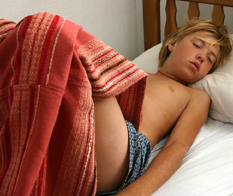 Shirtless Boy Sleeping In Bed