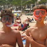 shirtless kids with snorkels and masks