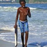 Young Shirtless Black Boy At Beach