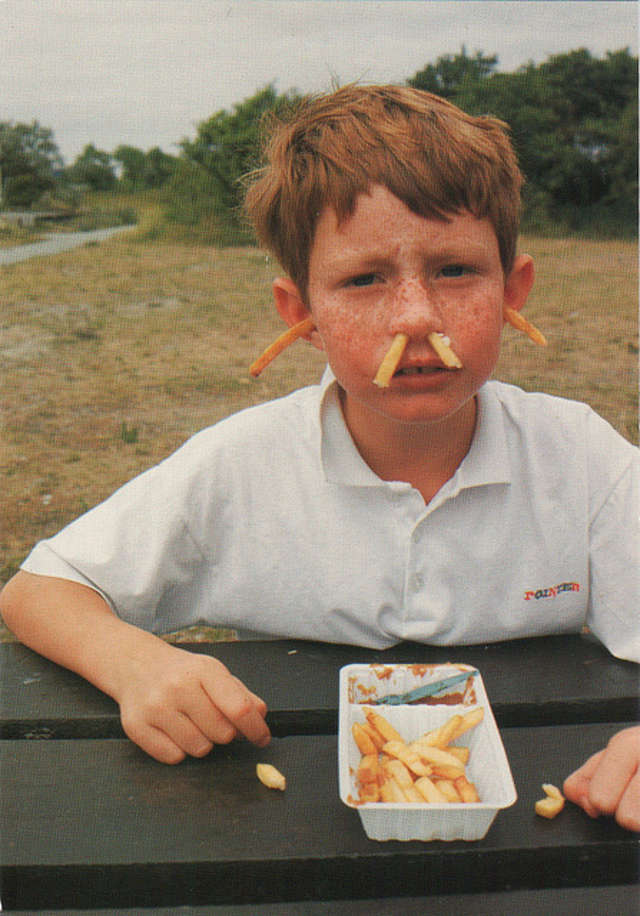Boy With French Fries In Ears and Nose
