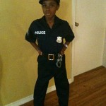 black-boy-dressed-as-policeman