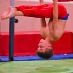 Boy Practicing On Rings