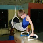 Boy Practices On Pommel Horse