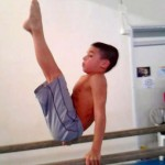Boy On Parallel Bars