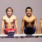 Gymnast Boys Pose On Parallel Bars