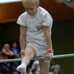 Boy On Uneven Bar