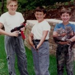 2 Boys With Guns 1 Boy With Kitten and Cat