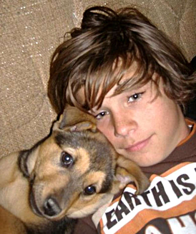 Boy Relaxing With Dog