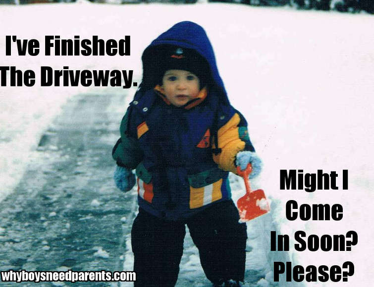 Boy Shoveling Snow From Driveway