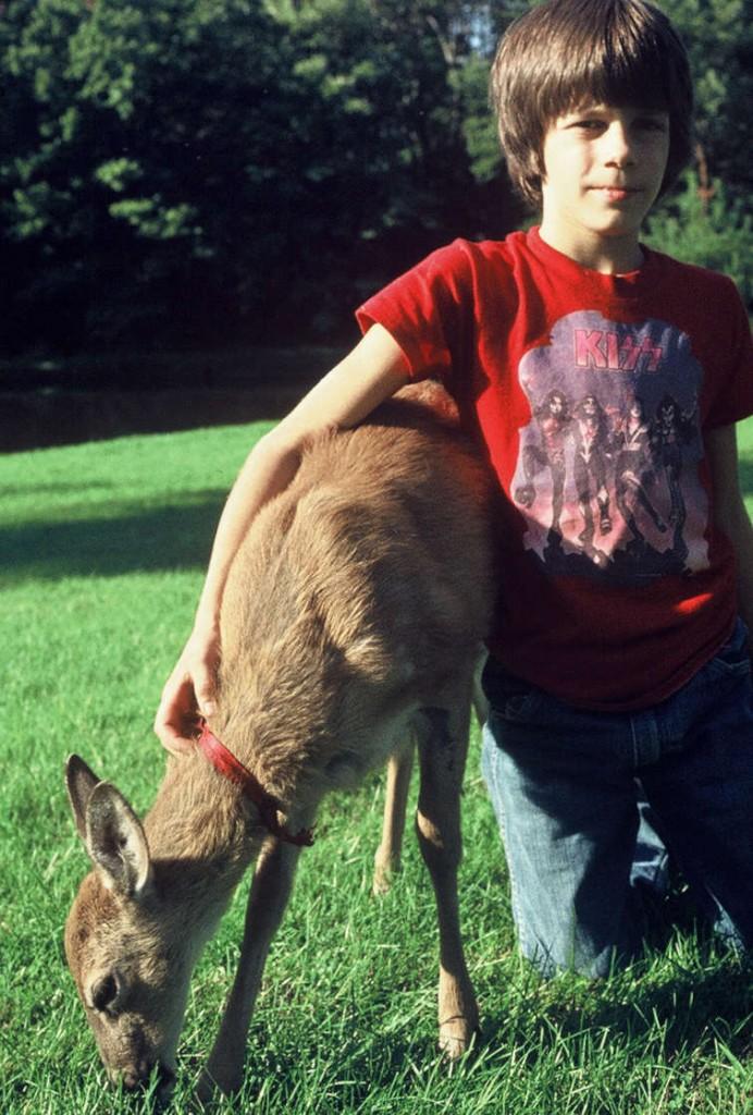 Boy With Pet Deer
