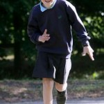 Boy Running In Skirt Protest