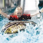 Happy boy on log flume
