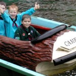 Boys riding log flume