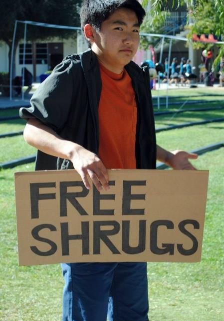 Boy Gives Free Shrugs