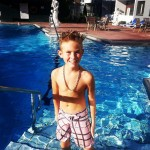 Boy Wearing Huge Chain At Swimming Pool
