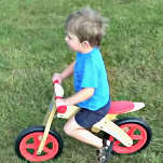 Boy Learning To Ride A Bike