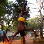Young Boy Practicing Mallakhamb
