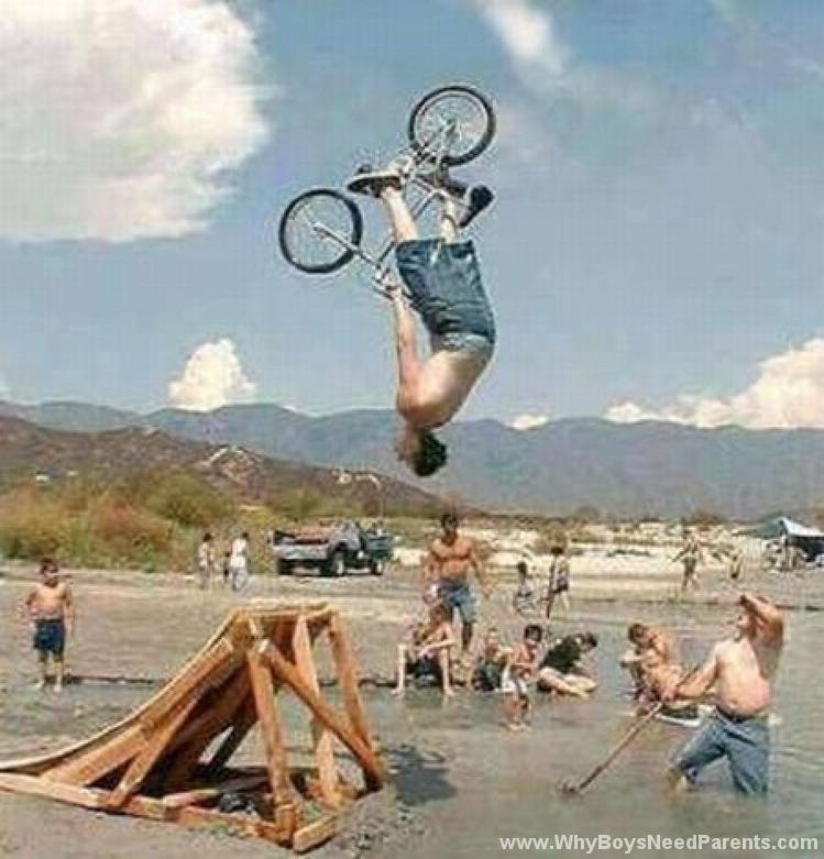 Boy Flipping Bike