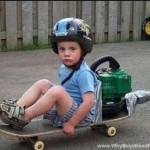 Boy Sitting On Motorized Skateboard