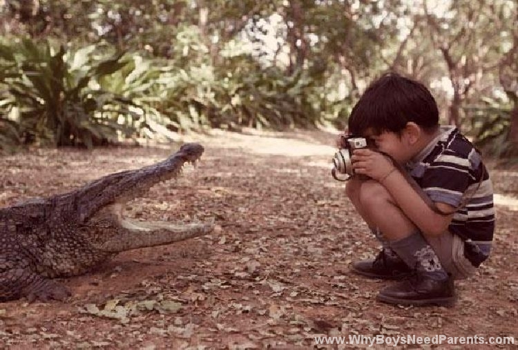 Boy Photographing Alligator